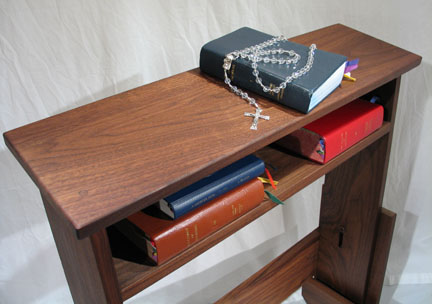Prayer bench with prayer books and rosary